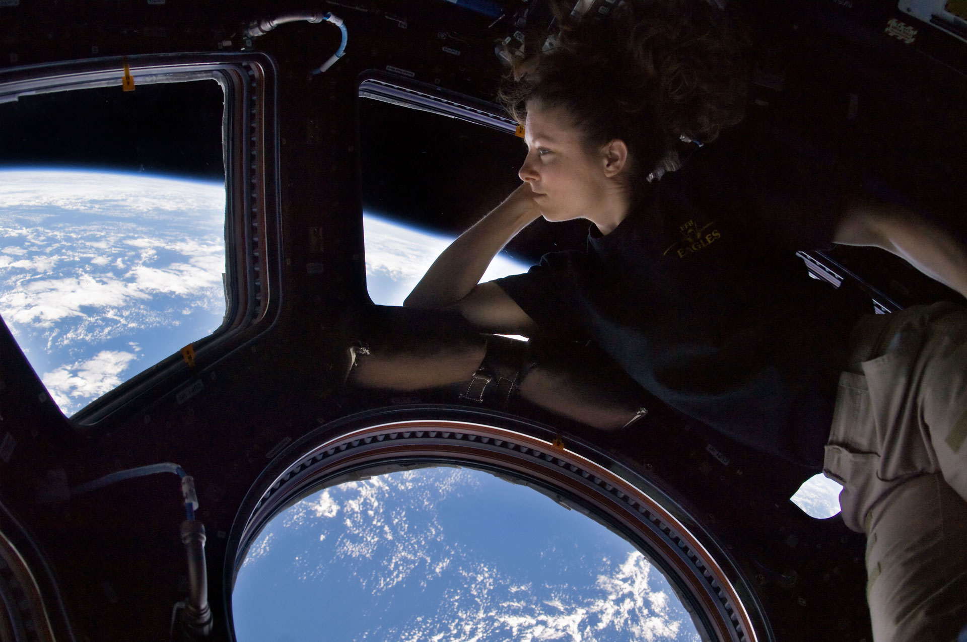 Self portrait of Tracy Caldwell Dyson in the Cupola module of the International Space Station observing the Earth below during Expedition 24. Image from NASA website - click image to be taken to original source and copyright information.